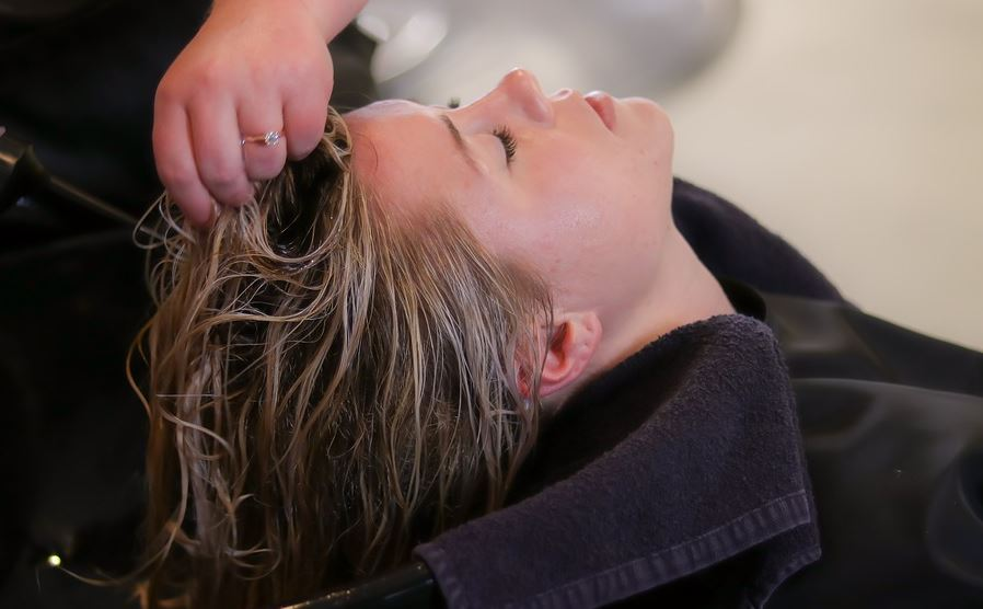woman drying detoxified hair
